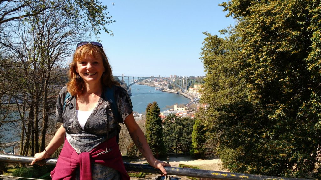 Jane Clements Life Coach standing in front of the bridge in Porto