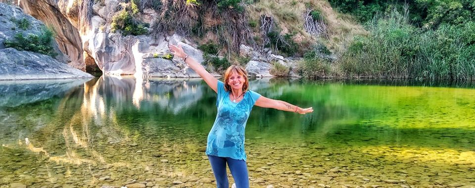 Jane Clements Life Coach standing in front of a green water pool